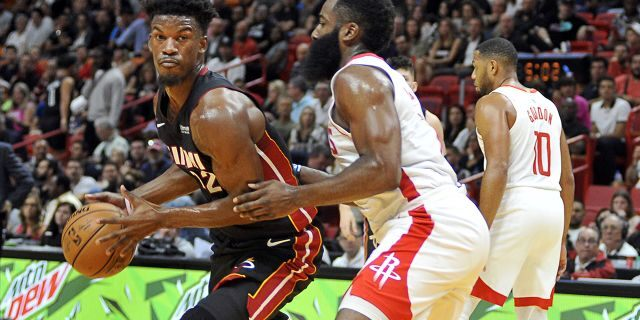 Miami Heat guard Jimmy Butler, left, drives against Houston Rockets guard James Harden during the first half of an NBA basketball game, Sunday, Nov. 3, 2019, in Miami. (AP Photo/Gaston De Cardenas)
