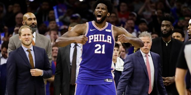 Philadelphia 76ers' Joel Embiid reacts after it was announced that he and Minnesota Timberwolves' Karl-Anthony Towns were ejected, during the second half of an NBA basketball game Wednesday, Oct. 30, 2019, in Philadelphia. The 76ers won 117-95. (AP Photo/Matt Rourke)