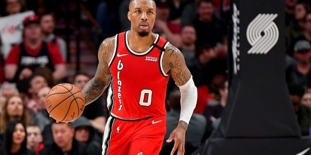 PORTLAND, OREGON - MARCH 10: Damian Lillard #0 of the Portland Trail Blazers brings the ball down the court during the second half of the game against the Phoenix Suns at the Moda Center on March 10, 2020 in Portland, Oregon. The Portland Trail Blazers topped the Phoenix Suns, 121-105. NOTE TO USER: User expressly acknowledges and agrees that, by downloading and or using this photograph, User is consenting to the terms and conditions of the Getty Images License Agreement. (Photo by Alika Jenner/Getty Images)