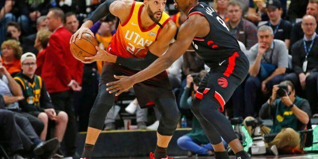 Toronto Raptors center Serge Ibaka (9) guards against Utah Jazz center Rudy Gobert (27) in the first half during an NBA basketball game Monday, March 9, 2020, in Salt Lake City. (AP Photo/Rick Bowmer)