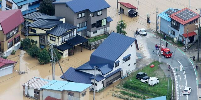 A residential area is flooded following a heavy rain in Okura village, Yamagata prefecture, northern Japan Wednesday, July 29, 2020.