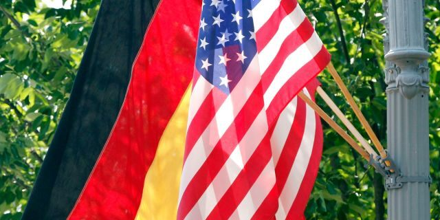 In this 2011 file photo, the German and U.S. flags fly on a lamp post in front of the White House in Washington ahead of German Chancellor Angela Merkel's visit. Defense officials say the U.S. will pull 12,000 troops from Germany, bringing 6,400 forces home and shifting 5,600 to other countries in Europe, including Italy and Belgium. The plan will cost billions of dollars and take years to complete. (AP)