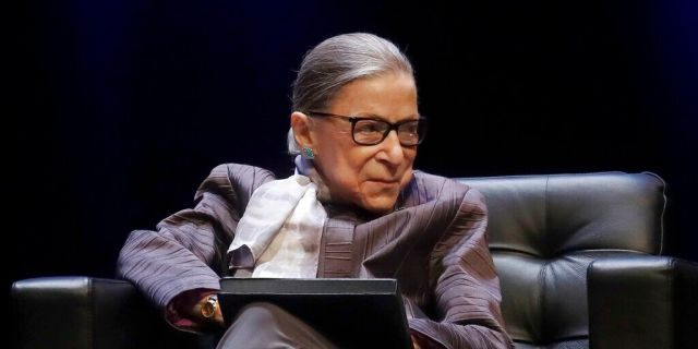 FILE - In this Oct. 21, 2019, file photo U.S. Supreme Court Justice Ruth Bader Ginsburg listens to speakers during the inaugural Herma Hill Kay Memorial Lecture at the University of California at Berkeley in Berkeley, Calif. At 87, Ginsburg is the oldest member of the court. Her next oldest colleagues are 81-year-old Stephen Breyer, 72-year-old Clarence Thomas and 70-year-old Samuel Alito. (AP Photo/Jeff Chiu, File)