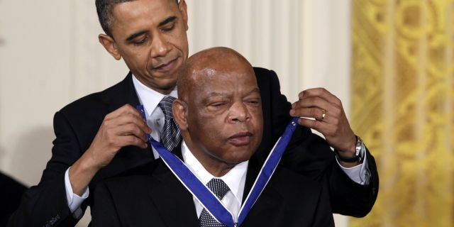 In this Feb. 15, 2011, file photo, President Barack Obama presents a 2010 Presidential Medal of Freedom to U.S. Rep. John Lewis, D-Ga., during a ceremony in the East Room of the White House in Washington. Lewis, who carried the struggle against racial discrimination from Southern battlegrounds of the 1960s to the halls of Congress, died Friday, July 17, 2020. (AP Photo/Carolyn Kaster, File)