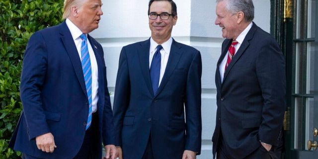 President Donald Trump, Treasury Secretary Steven Mnuchin, White House Chief of Staff Mark Meadows talk before Trump speaks with reporters on the South Lawn of the White House, Wednesday, July 29, 2020, in Washington. Trump is en route to Texas. (AP Photo/Alex Brandon)