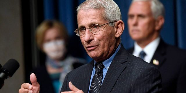 FILE - In this June 26, 2020, file photo Director of the National Institute of Allergy and Infectious Diseases Dr. Anthony Fauci, center, speaks during a news conference with members of the Coronavirus task force at the Department of Health and Human Services in Washington. (AP Photo/Susan Walsh, File)