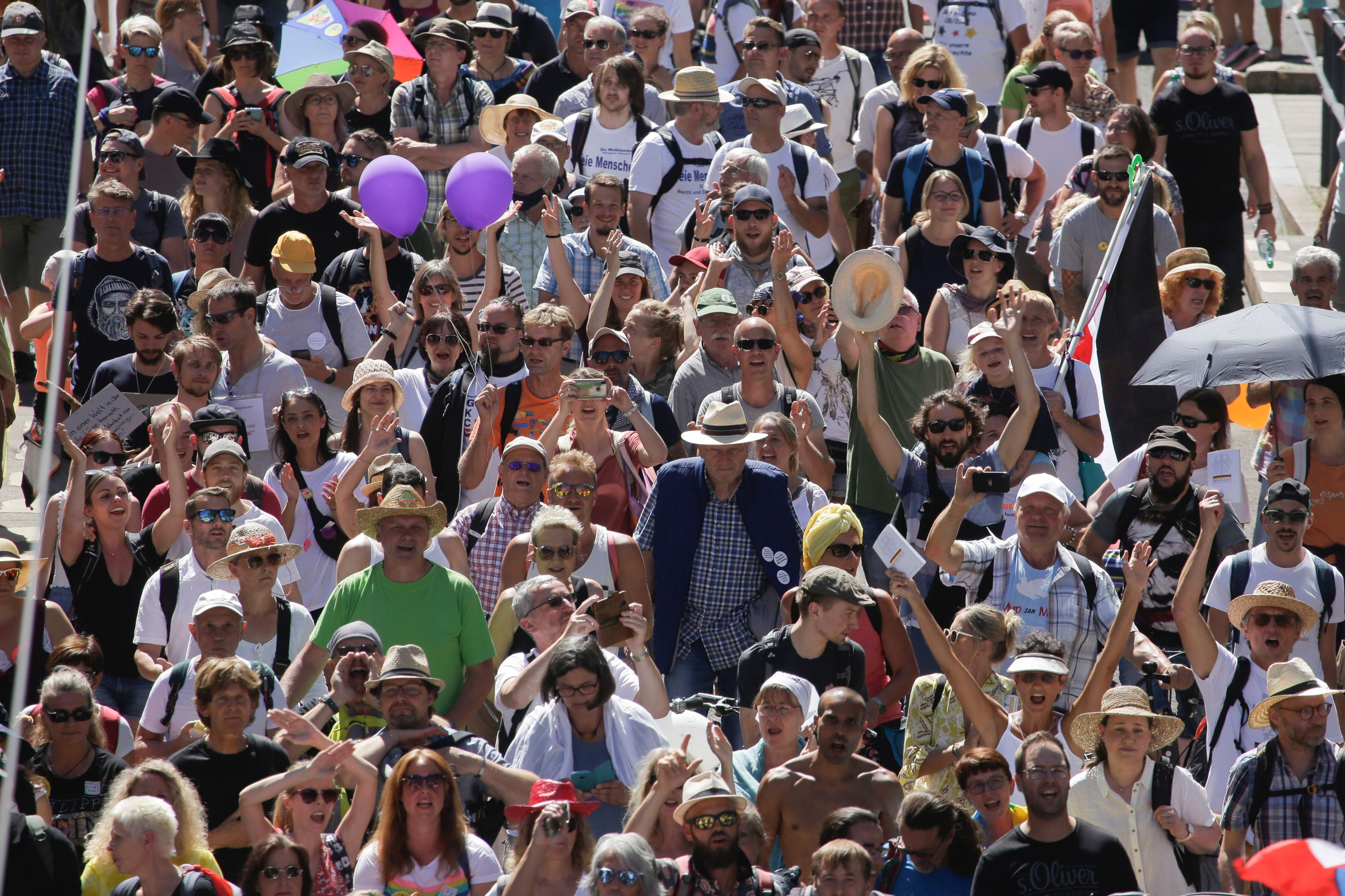 People mostly without face masks attend a demonstration with the slogan against coronavirus restrictions in Berlin, Germany,