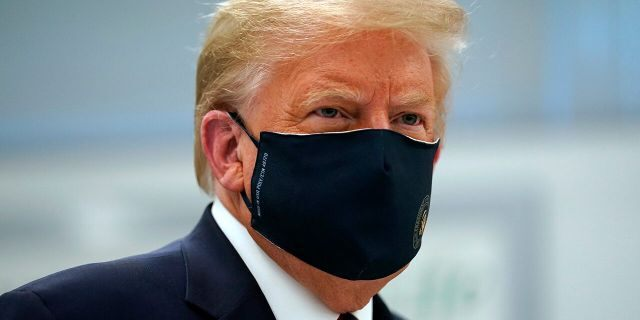President Trump wears a face mask as he participates in a tour of Bioprocess Innovation Center at Fujifilm Diosynth Biotechnologies, July 27, 2020, in Morrisville, N.C. (AP Photo/Evan Vucci)