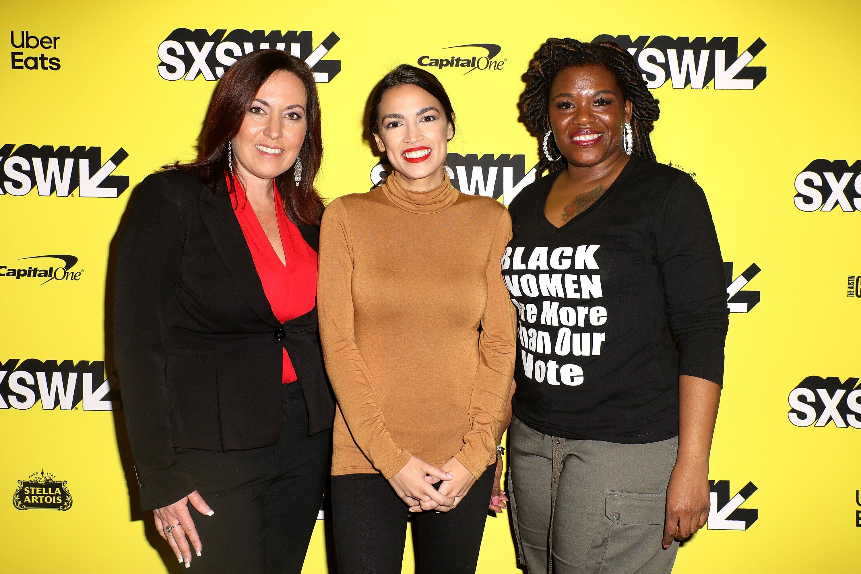 """Cori Bush, right, joins Amy Vilela, left, and Rep. Alexandria Ocasio-Cortez (D-N.Y.) at the premiere of the documentary """"Knoc"""