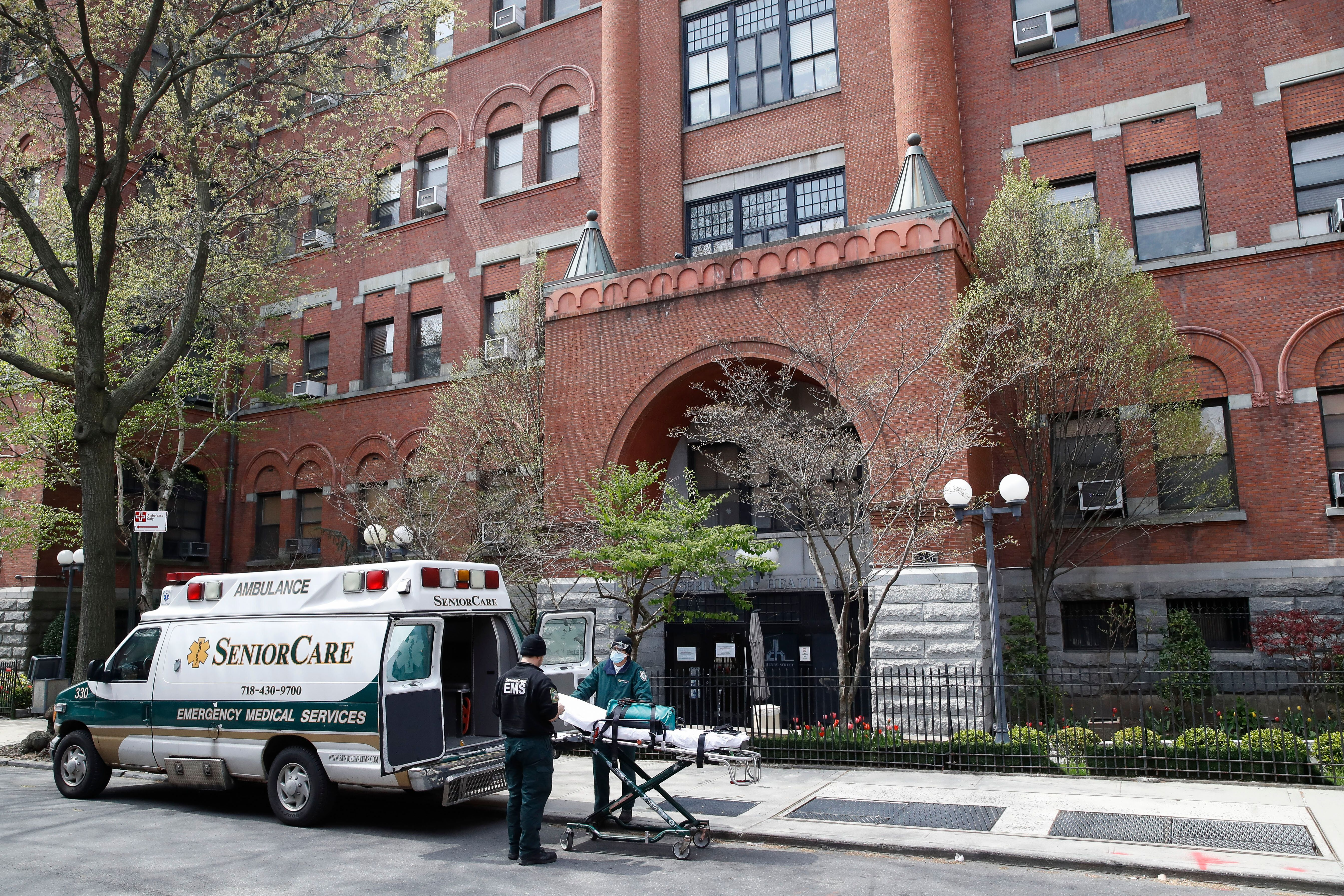 In this April 17, 2020, file photo, emergency medical workers arrive at Cobble Hill Health Center in the Brooklyn borough of