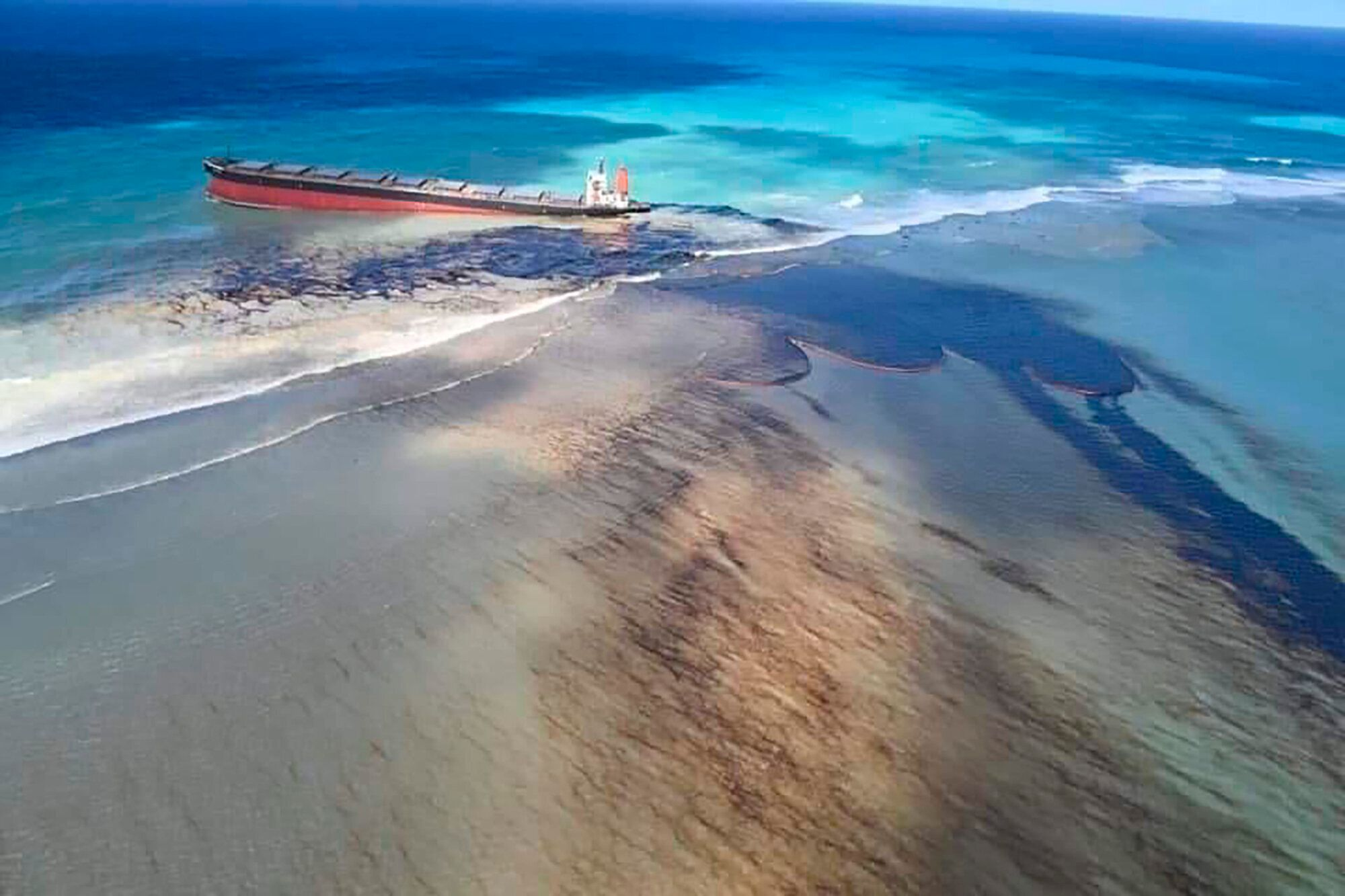 """Oil can be seen leaking from the MV Wakashio as Mauritius declared a """"state of environmental emergency."""""""