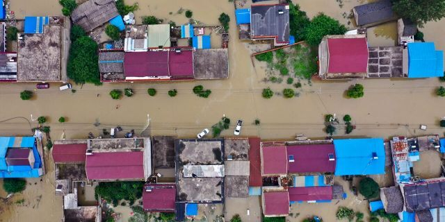 In this July 20, 2020, aerial file photo released by Xinhua News Agency shows the extent of flooding in Guzhen Town of Lu'an City in eastern China's Anhui Province.