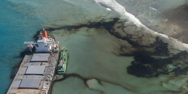 This photo provided by the French Army shows oil leaking Tuesday from the MV Wakashio, a bulk carrier ship that ran aground off the southeast coast of Mauritius (EMAE/AP)
