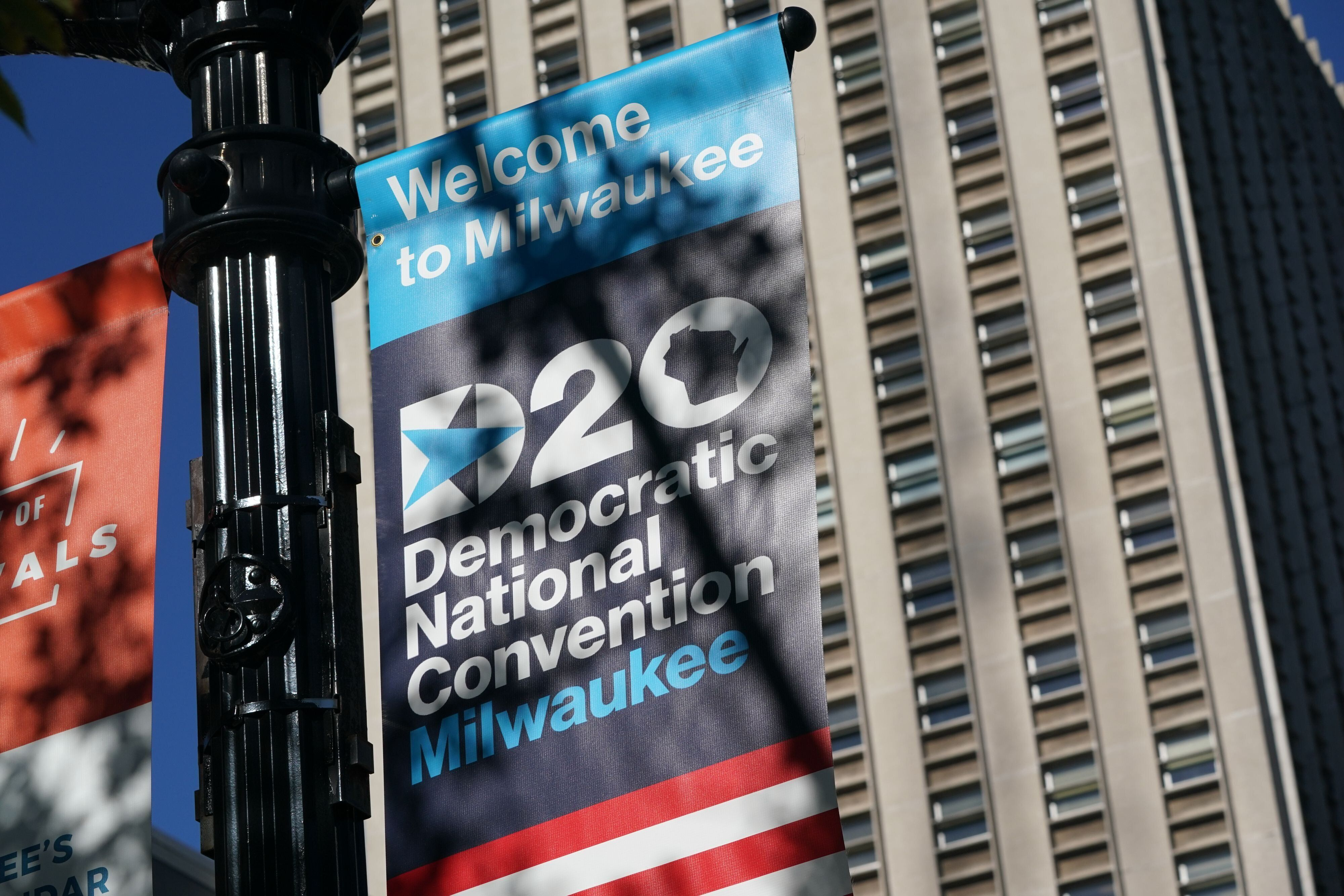 A sign advertises the 2020 Democratic National Convention at the Wisconsin Center, which will be the production hub for the a