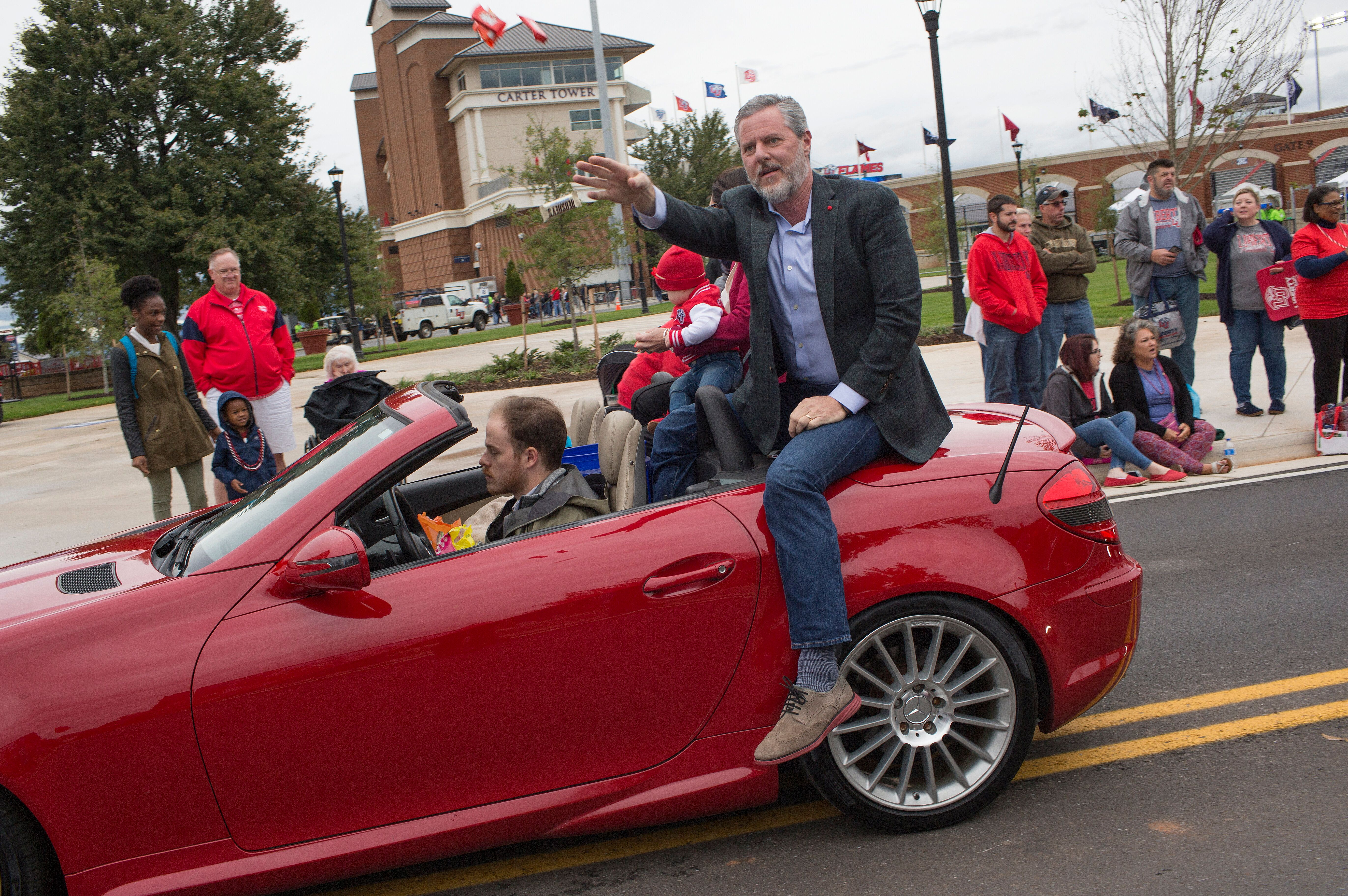 President of Liberty University Jerry Falwell Jr. rides in the annual homecoming weekend parade on October 20, 2018 in Lynchb
