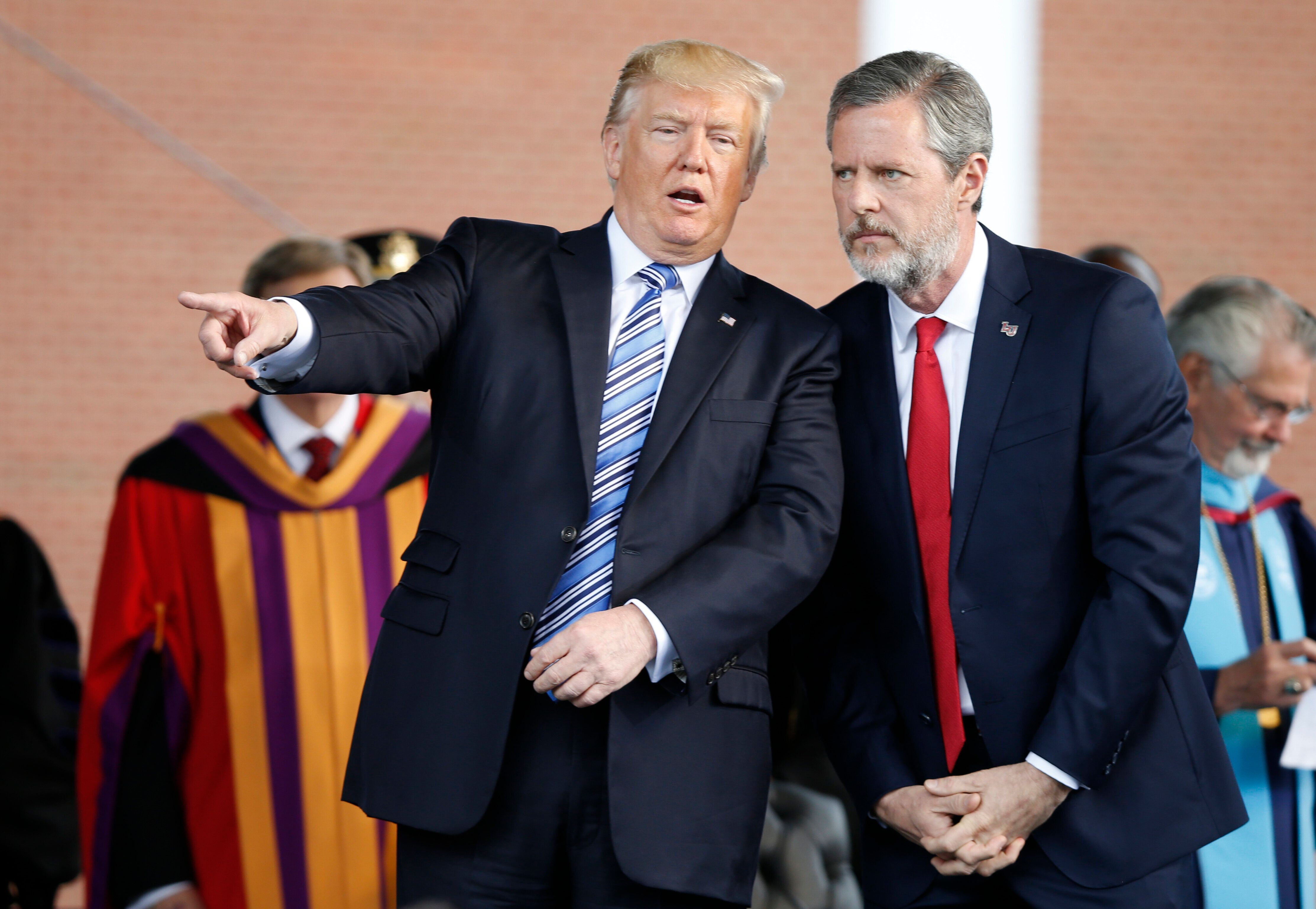 In this May 13, 2017 file photo, President Donald Trump gestures as he stands with Liberty University president, Jerry Falwel