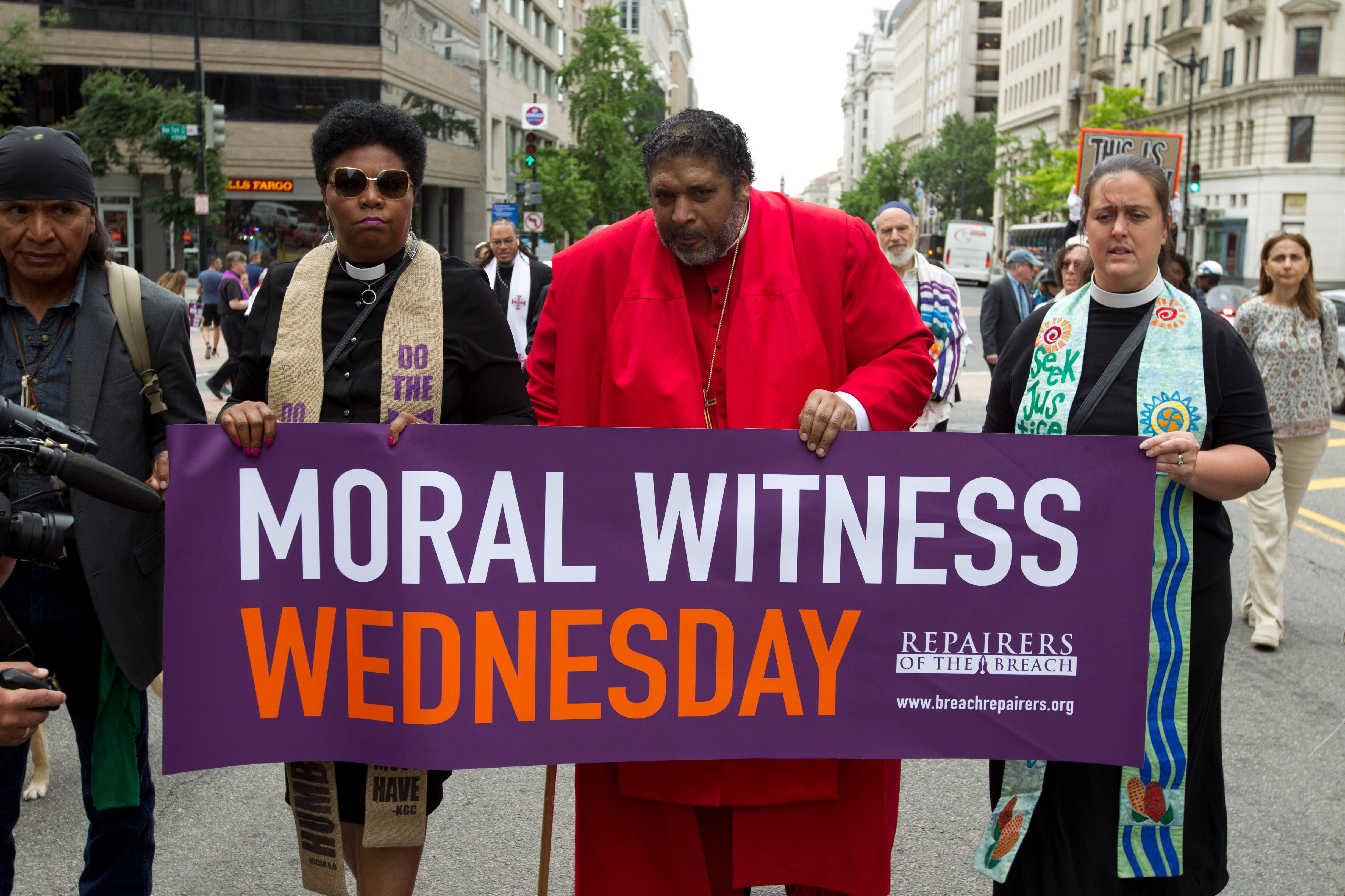 In this Wednesday, June 12, 2019 file photo, Rev. William Barber and fellow faith leaders march to the White House to protest