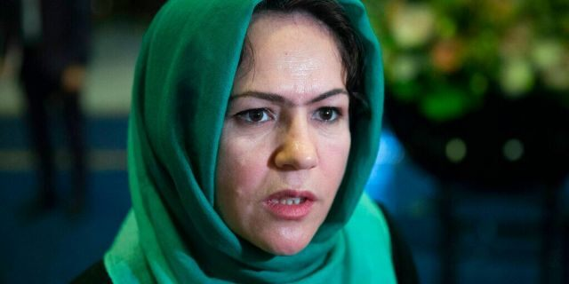"""Afghan politician Fawzia Koofi speaks to media before the """"intra-Afghan"""" talks in Moscow, Russia, in 2019. (AP Photo/Pavel Golovkin)"""