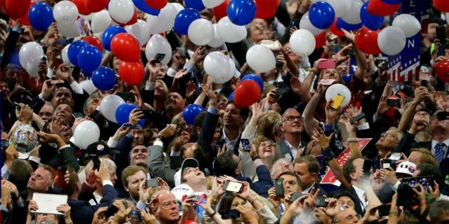FILE - In this July 21, 2016, file photo, confetti and balloons fall during celebrations after Republican presidential candidate Donald Trump's acceptance speech on the final day of the Republican National Convention in Cleveland.  (AP Photo/Matt Rourke, File)
