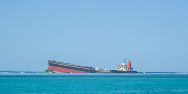 The MV Wakashio, a bulk carrier ship that recently ran aground off the southeast coast of Mauritius, can bee seen from the coast or Mauritius, Wednesday Aug. 12, 2020.