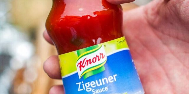"""FILE: A man holds a bottle of """"gypsy sauce"""" from the manufacturer Knorr in his hand in Berlin, Germany."""