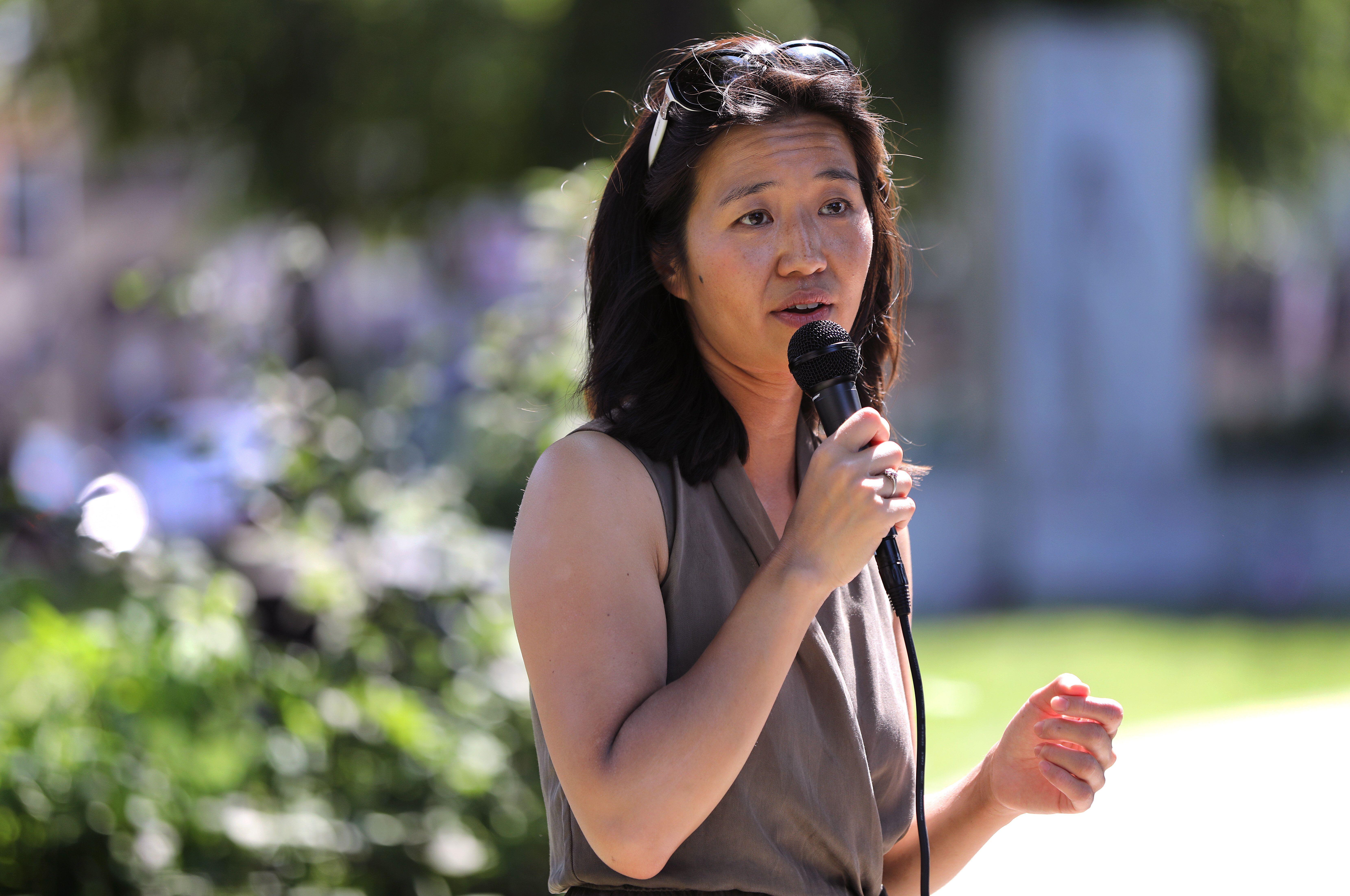 Michelle Wu speaks to voters at Adams Park in the Roslindale neighborhood of Boston.