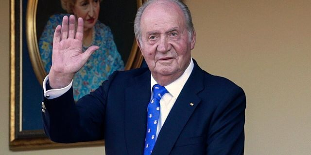 In this Sunday, June 2, 2019 file photo, Spain's former King Juan Carlos waves during a bullfight at the bullring in Aranjuez, Madrid, Spain. Spain's royal household said on Monday, Aug. 17, 2020, that Juan Carlos is in the United Arab Emirates, resolving a mystery over his whereabouts that has swirled in Spain since he announced he was leaving the country amid a growing financial scandal. (AP Photo/Andrea Comas, File)