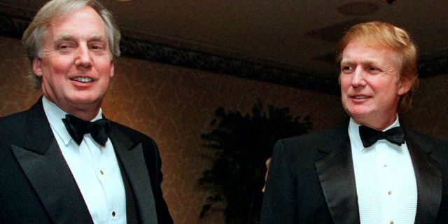 FILE - In this Nov. 3, 1999, file photo, Robert Trump, left, joins then real estate developer and presidential hopeful Donald Trump at an event in New York. President Donald Trump's younger brother, Robert Trump, a businessman known for an even keel that seemed almost incompatible with the family name, died Saturday night, Aug. 15, 2020, after being hospitalized in New York, the president said in a statement. He was 71. The president visited his brother at a New York City hospital Friday after White House officials said Robert Trump had become seriously ill. (AP Photo/Diane Bonadreff, File)