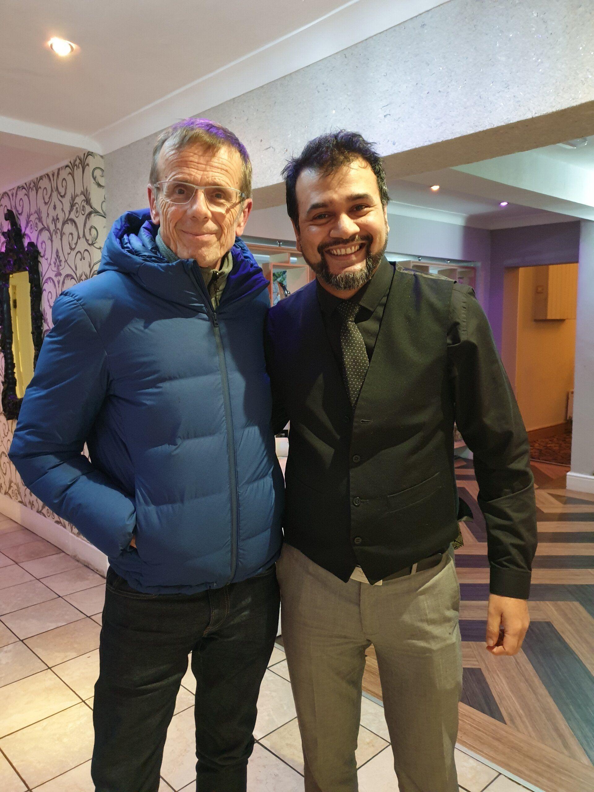 Firoz Ali next to actor Tom Watt