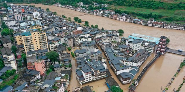 In this aerial photo released by China's Xinhua News Agency, flooding is seen in Bikou township of Longnan city in northwestern China's Gansu Province, Tuesday, Aug. 18, 2020.