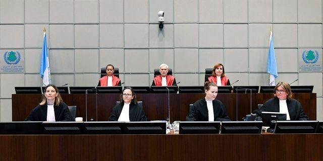 Presiding Judge, Judge David Re, back centre, with Judge Janet Nosworthy, left, and Judge Micheline Braidy, during a session of the United Nations-backed Lebanon Tribunal in Leidschendam, Netherlands Tuesday Aug. 18, 2020, where it is scheduled to hand down it's judgement in the case against four men being tried for the bombing that killed former Lebanon Prime Minister Rafik Hariri and 21 other people. The U.N.-backed tribunal in the Netherlands is to deliver verdicts in the trial held in absentia of four members of the militant Lebanese Hezbollah group accused of involvement in the truck bomb assassination of former Lebanese Prime Minister Rafik Hariri in 2005. (Piroschka Van De Wouw/Pool via AP)