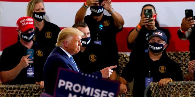 President Donald Trump arrives to speak to a crowd of supporters at the Yuma International Airport Tuesday, Aug. 18, 2020, in Yuma, Ariz. (AP Photo/Matt York)