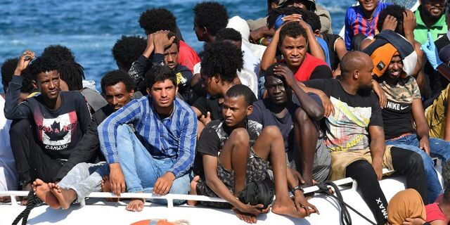 Migrants from Tunisia and Lybia arrive onboard of an Italian Guardia Costiera (Coast Guard) boat in the Italian Pelagie Island of Lampedusa on August 1, 2020.