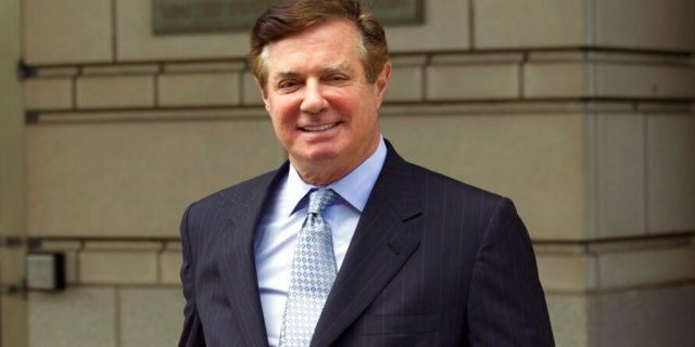 In this May 23, 2018, file photo, Paul Manafort, President Donald Trump's former campaign chairman, leaves the Federal District Court after a hearing in Washington. Manafort faces his second sentencing hearing in his many weeks, with a judge expected to tack on additional prison time beyond the roughly four-year punishment he has already received. (AP Photo/Jose Luis Magana, File)