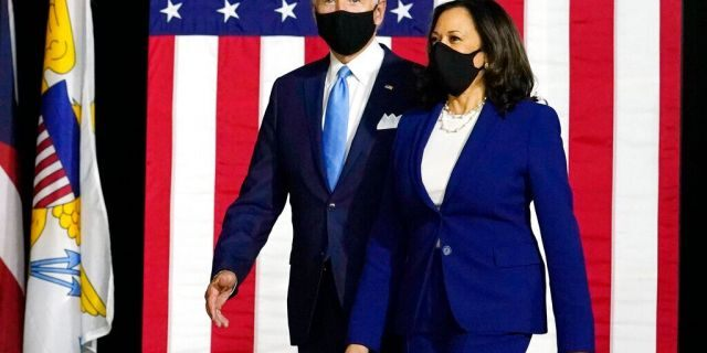 In this Aug. 12, 2020, file photo Democratic presidential candidate former Vice President Joe Biden and his running mate Sen. Kamala Harris, D-Calif., arrive to speak at a news conference at Alexis Dupont High School in Wilmington, Del. (AP Photo/Carolyn Kaster)