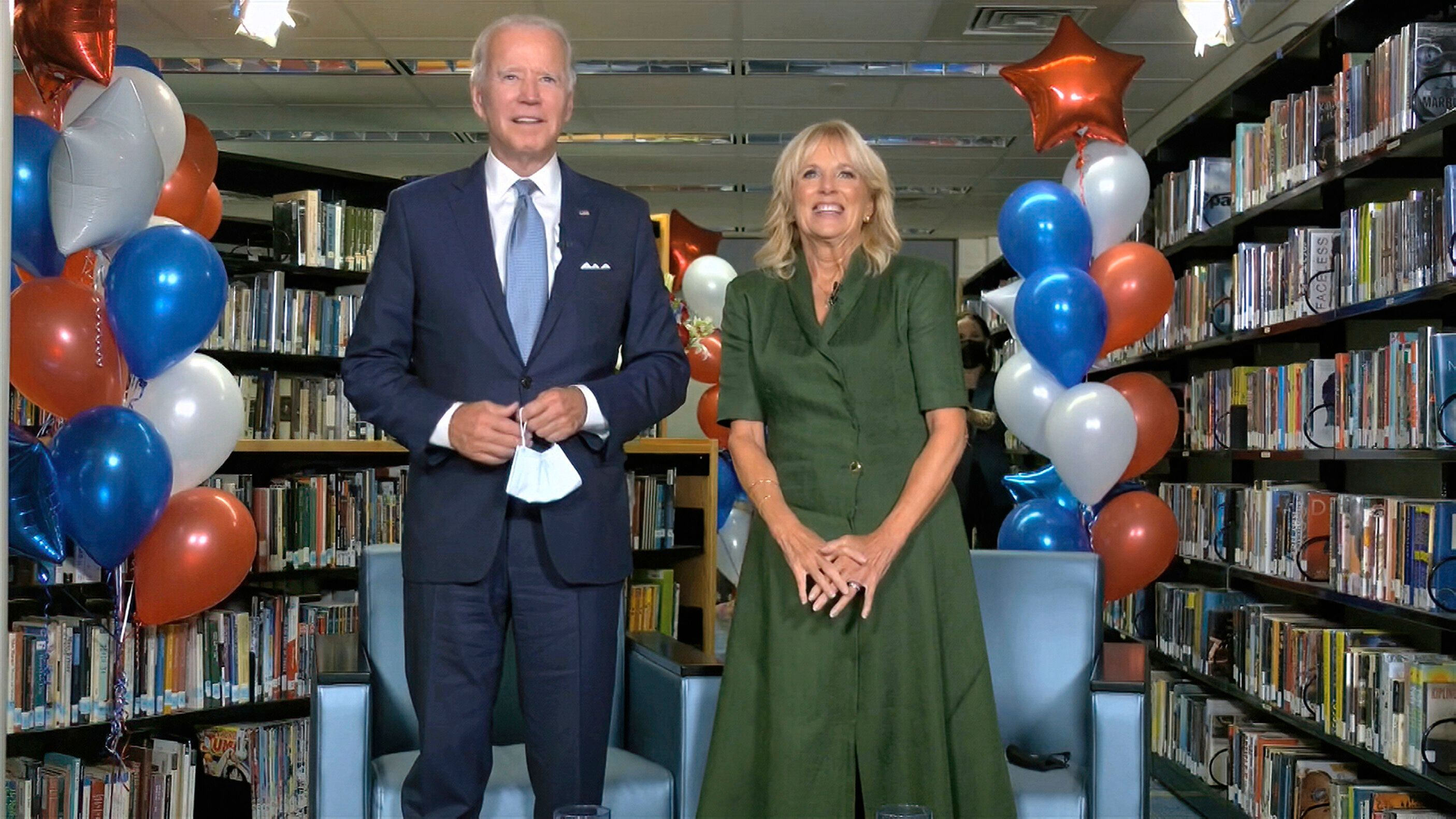 In this image from video, former Vice President Joe Biden, his wife, Jill Biden, and members of their family celebrate after