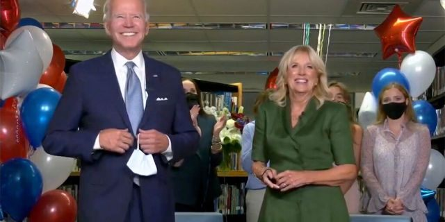 In this screenshot from the DNCC's livestream of the 2020 Democratic National Convention, Democratic presidential nominee former Vice President Joe Biden and Dr. Jill Biden together gives a thank you speech with supporters during the virtual convention on August 18, 2020. (Photo by Handout/DNCC via Getty Images)