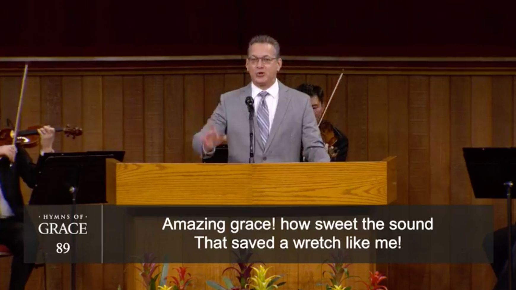 A musical minister at Grace Community Church leads the congregation in a hymn on Aug. 16.