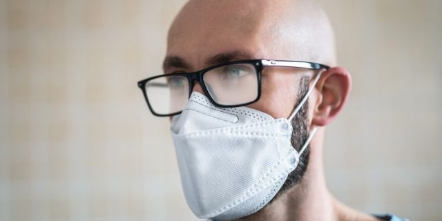 Face masks trap the breath and foster humidity so glasses wearers may have noticed that wearing a face mask can cause the lenses to fog. (iStock)