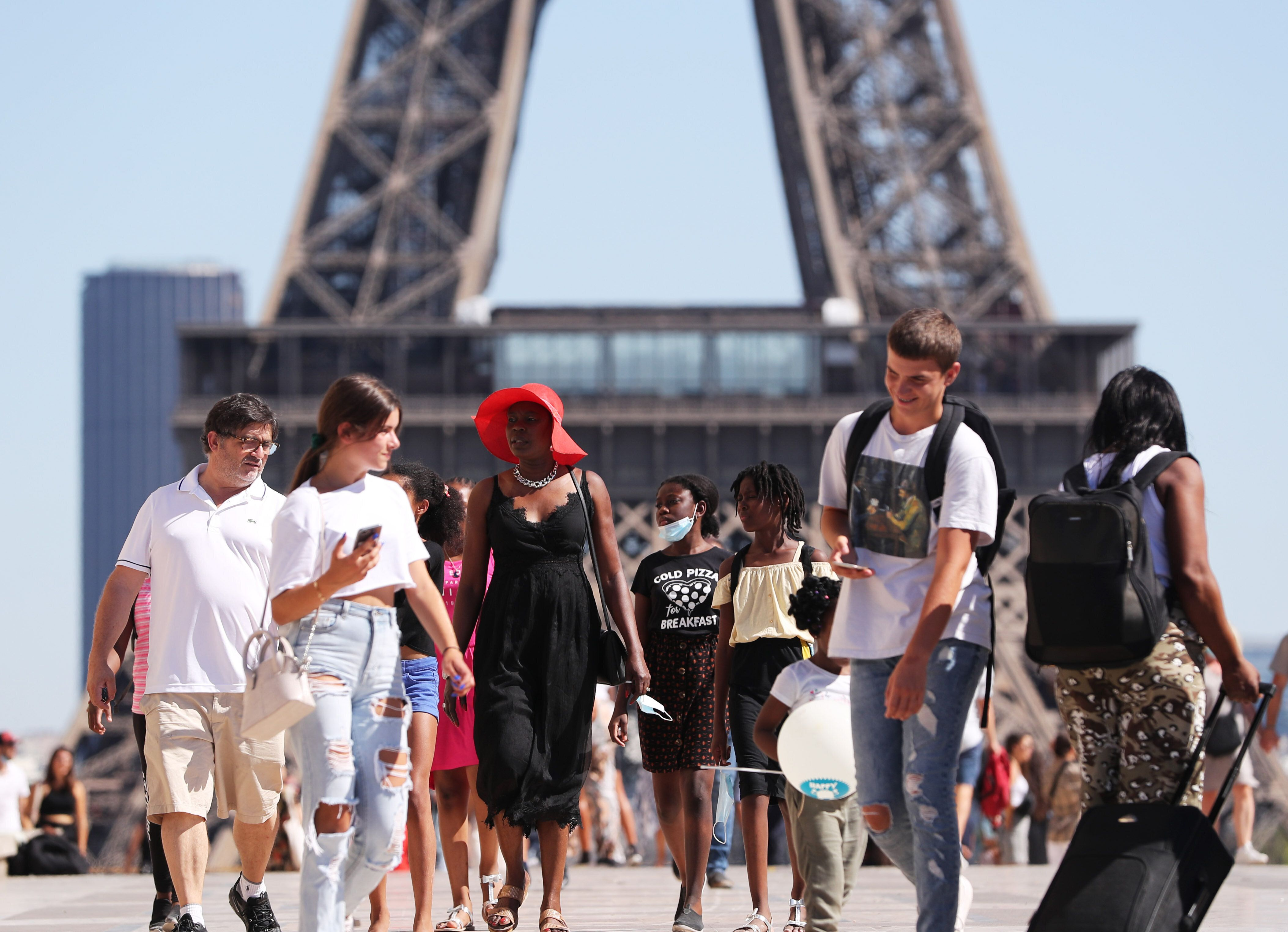 People enjoy the summer weather in Paris, France, on August 7.