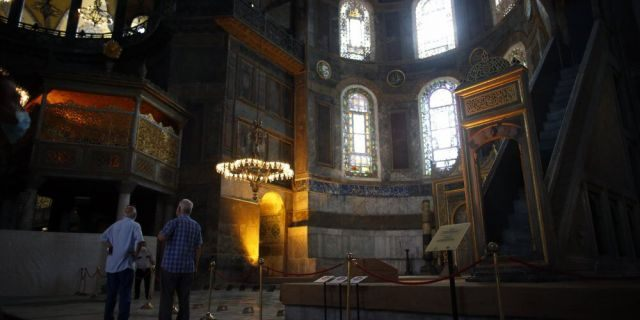 People visit the Byzantine-era Hagia Sophia, an UNESCO World Heritage site and one of Istanbul's main tourist attractions in the historic Sultanahmet district of Istanbul, July 10.