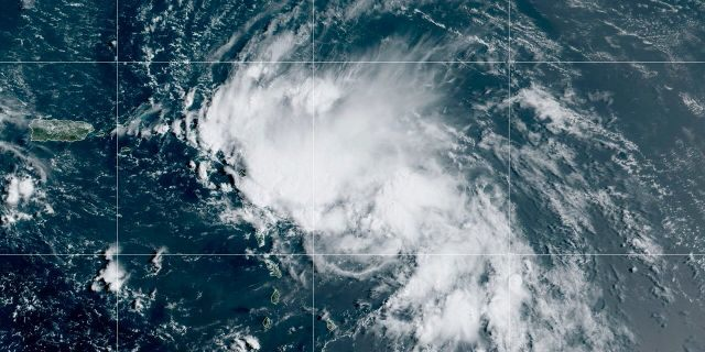 This satellite image released by the National Oceanic and Atmospheric Administration (NOAA) shows Tropical Storm Laura in the North Atlantic Ocean, Friday, Aug. 21, 2020. Laura formed Friday in the eastern Caribbean and forecasters said it poses a potential hurricane threat to Florida and the U.S. Gulf Coast. A second storm also may hit the U.S. after running into Mexico's Yucatan Peninsula. (NOAA via AP)