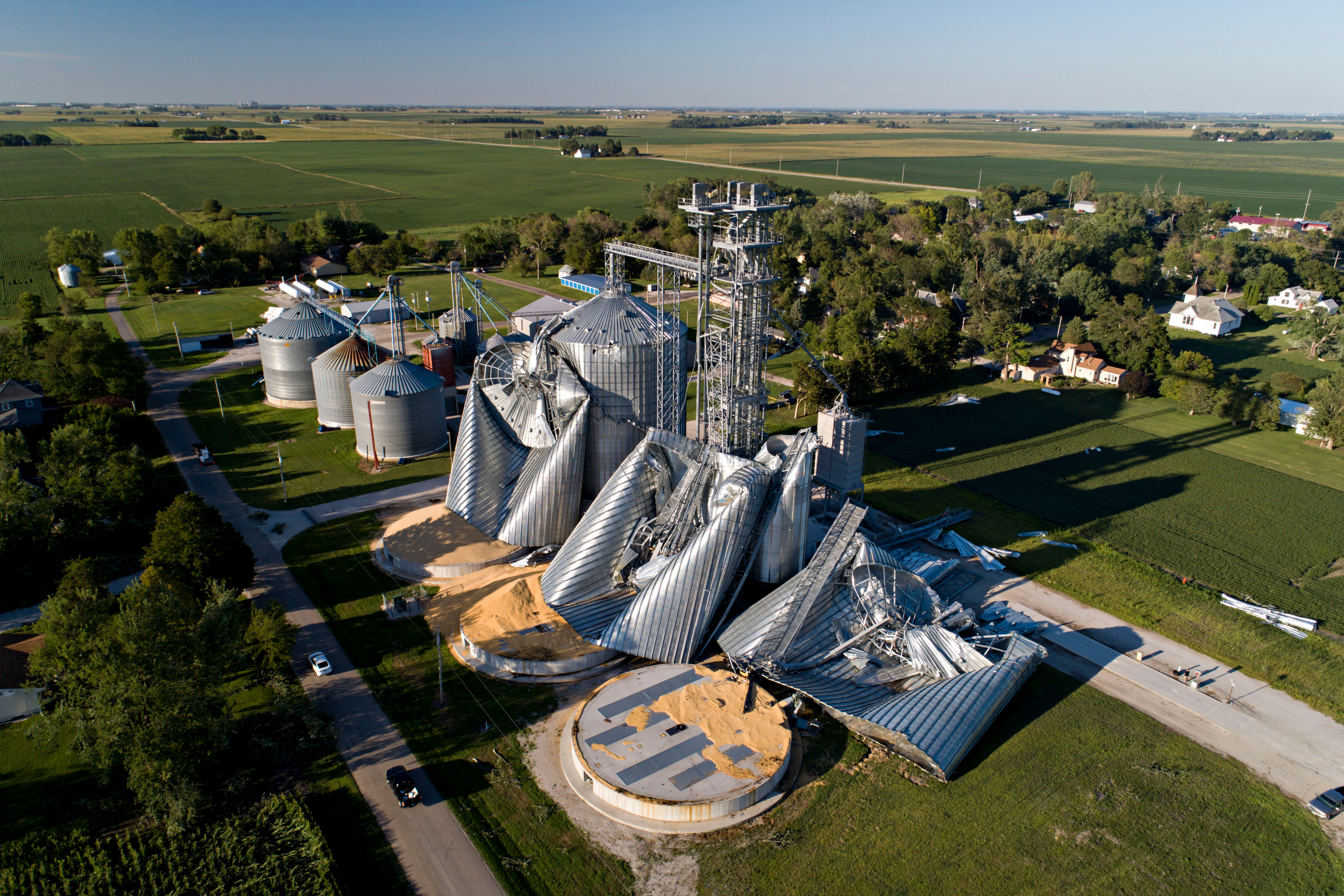 Damaged grain bins are shown at the Heartland Co-Op grain elevator on Aug. 11, in Luther, Iowa, after a powerful derecho batt