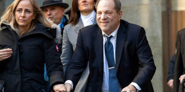 """In this Feb. 21, 2020, file photo, Harvey Weinstein leaves the courthouse during jury deliberations in his rape trial in New York. With Weinstein facing sentencing this week, his lawyers argued Monday, March 9, that the disgraced movie mogul deserves mercy in his New York City rape case because he's already suffered a """"historic"""" fall from grace and is dealing with serious health issues."""
