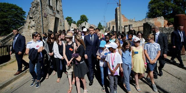 French President Emmanuel Macron attends a visit of the ruins in the French martyr village of Oradour-sur-Glane, France June 10, 2017. (REUTERS/Stephane Mahe/File Photo)