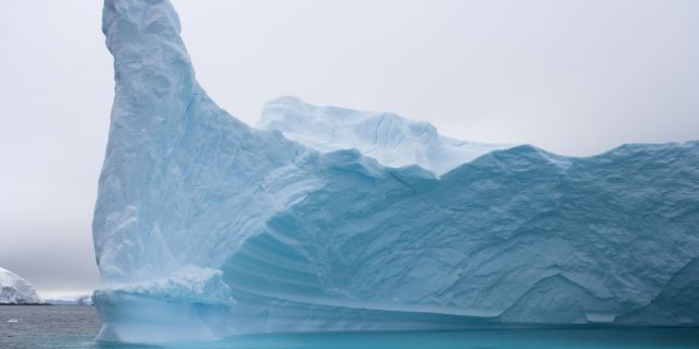File photo: Iceberg floating off the western Antarctic peninsula, Antarctica, Southern Ocean. (Photo by Steven Kazlowski / Barcroft Media / Getty Images)