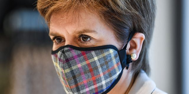 First Minister of Scotland Nicola Sturgeon wears a Tartan face mask as she visits New Look at Ford Kinaird Retail Park on June 26, 2020, in Edinburgh, Scotland.
