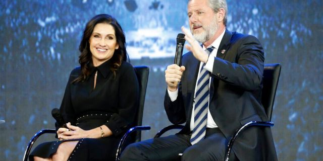 Rev. Jerry Falwell Jr., right, and his wife, Becki during after a town hall at a convocation at Liberty University in Lynchburg, Va.