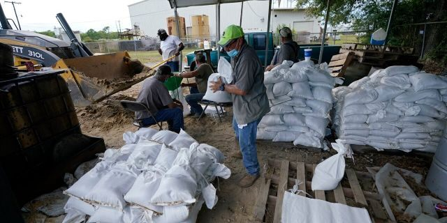 Municipal workers fill sandbags for the elderly and those with disabilities ahead of Hurricane Laura in Crowley, La., Tuesday, Aug. 25, 2020.