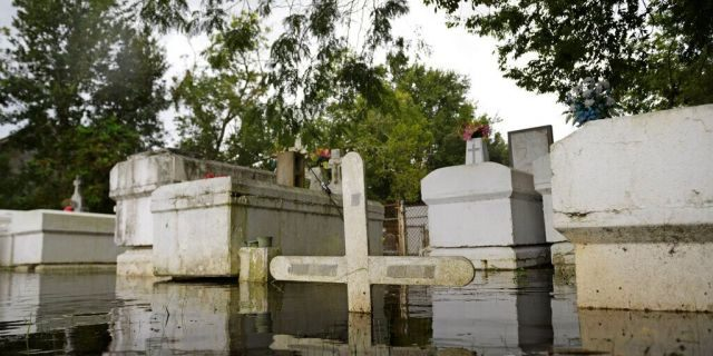 A cemetery along Privateer Blvd. in Barataria, La. is inundated in water as water levels surge before Hurricane Laura, Wednesday, Aug. 26, in Barataria, La. (Max Becherer/The Advocate via AP)